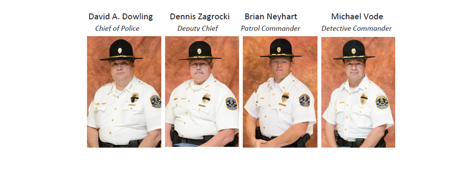 4 Senior Police Officers wearing their Dress Uniforms