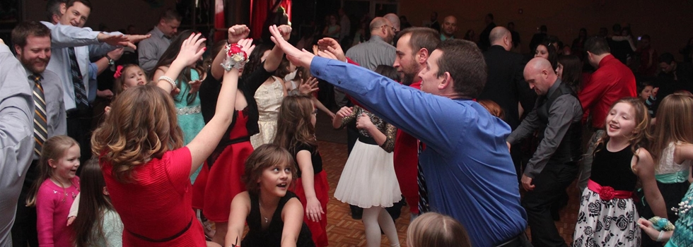 Fathers and Daughters dancing together at the Daddy/Daughter Dance