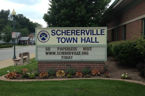"Outside of Schererville Town Hall, Looking at the Marquee Sign. ""Go Paperless Today"""